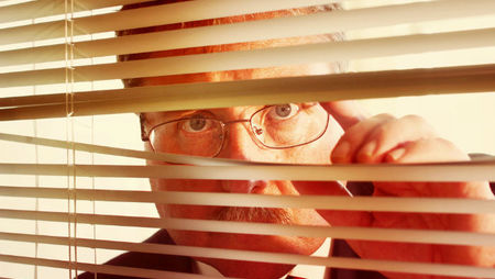 Micromanaging boss watching through blinds