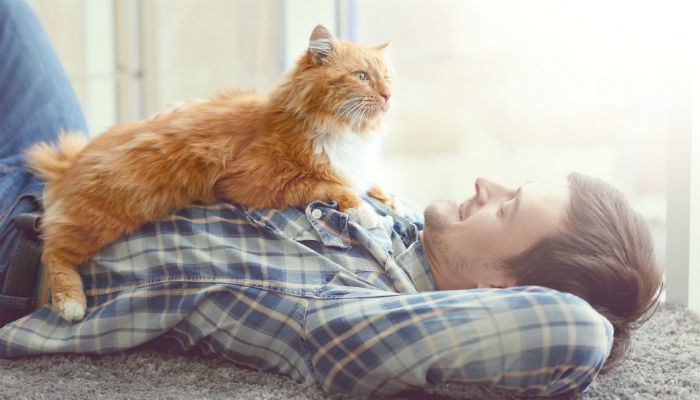 Young man with ginger cat