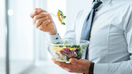 Businessman eating salad