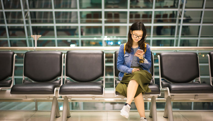 Young Asian woman waiting in airport