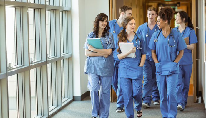 Group of medical students walking through corridor