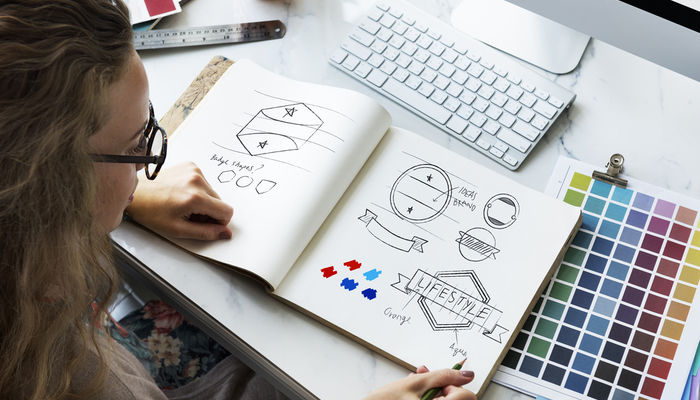 Young woman designing logos
