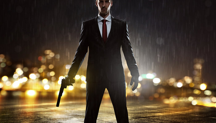 Young man holding a gun during a rainy night