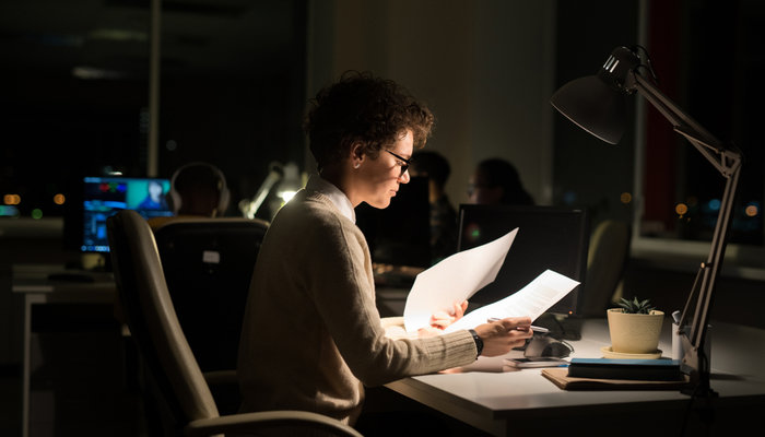Woman working in the office at night-time
