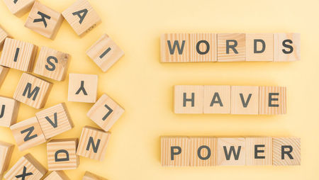 Wooden blocks spelling out the phrase 'words have power'