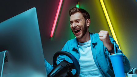 An excited man playing video games
