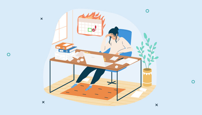 Illustration of an exhausted woman sitting at her desk