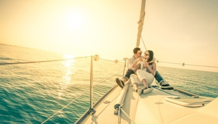 young couple in love on sail boat